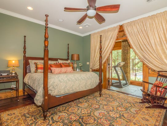 The large master suite includes outdoor views and a