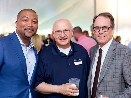 From left, Delbert Madison, Board Treasurer; Les Massey,