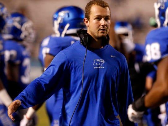 MTSUÕs injured quarterback Brent Stockstill talks with