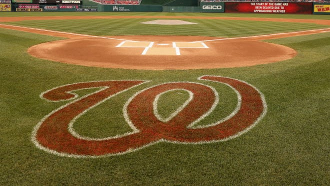 The field is shown during a weather delay between the Washington Nationals and Atlanta Braves at Nationals Park.