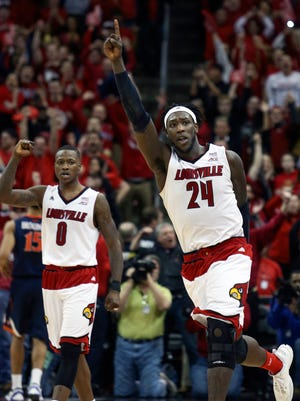 Louisville's Montrezl Harrell (24) and Terry Rozier celebrate in the final seconds of a win over Virginia this past season.