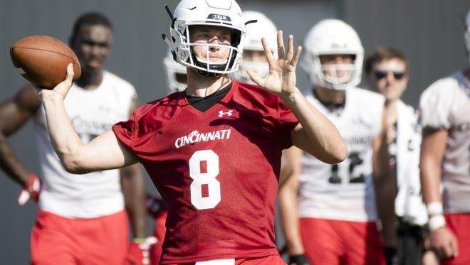Cincinnati Bearcats quarterback Hayden Moore (8) throws a pass during a recent practice at Camp Higher Ground. Moore holds the starting job but is facing competition from younger players.