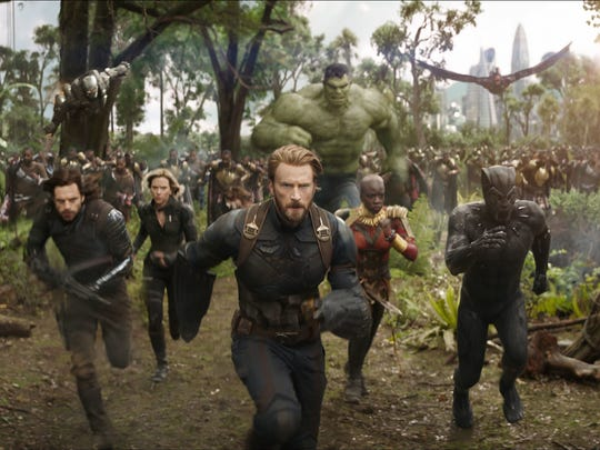 "Captain America (Chris Evans, center) and Black Panther (Chadwick Boseman, right) lead their allies in the fight against invading villains in ""Avengers: Infinity War."""