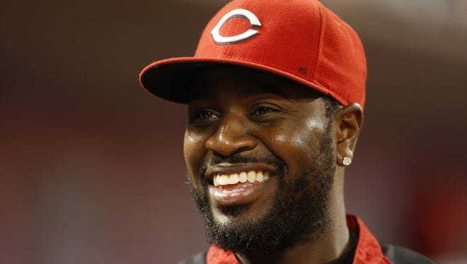 Cincinnati Reds second baseman Brandon Phillips (4) was all smiles in the dugout.