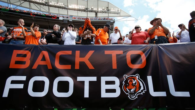 Cincinnati Bengals fans cheer the team against the Atlanta Falcons during the first quarter of their game played at Paul Brown Stadium in Cincinnati, Ohio Sunday September 14, 2014. The Enquirer/Gary Landers