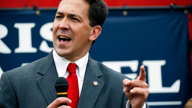 State Sen. Chris McDaniel speaks at a rally in Madison, Miss., Thursday, June 19, 2014. McDaniel is in a runoff against long-time U.S. Sen. Thad Cochran for the GOP nomination for Senate. Former Republican presidential candidate Rick Santorum spoke, and endorsed McDaniel at the rally. (AP Photo/Rogelio V. Solis)