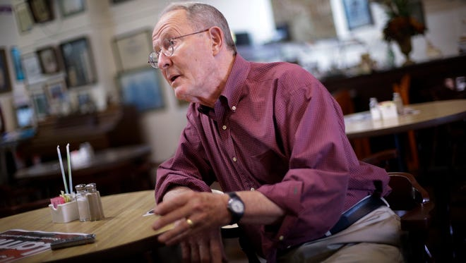 In this Aug. 5, 2014 photo, Sen. Lamar Alexander, R-Tenn., is interviewed after a campaign stop in a restaurant in Lawrenceburg, Tenn. Alexander, a 74-year-old incumbent, is seeking to fend off challenger Joe Carr in Tennessee's primary election Thursday. Carr has cast Alexander as out of touch with an increasingly conservative electorate. (AP Photo/Mark Humphrey)