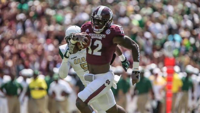 MSU's Robert Johnson (12) scores on a pass reception in the first quarter. Mississippi State played the University of Alabama Birmingham in a college football game on Saturday, September 6, 2014 at Davis Wade Stadium in Starkville, Miss. (Photo by Keith Warren)