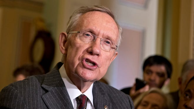 Senate Majority Leader Harry Reid, D-Nev., speaks with reporters at the Capitol in Washington in this file photo.