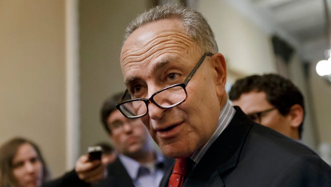 In this file photo, Sen. Charles Schumer, D-N.Y., the Democratic Policy Committee chairman, talks to the media on Capitol Hill in Washington. Schumer stood by the World Trade Center on Sunday, March 30, demanding that federal officials review security after daredevils twice sneaked to the top of the site's signature, 104-story skyscraper.