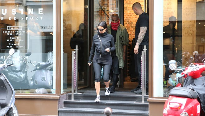 Kim Kardashian and U.S rap singer Kanye West  leave a fitness center in Paris on May 21, 2014. The gates of the Chateau de Versailles, once the digs of Louis XIV, will be thrown open to Kim Kardashian, Kanye West and their guests for a private evening this week ahead of their marriage.