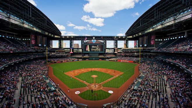Spectators attend a game at Chase Field.