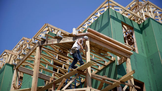 A builder works on a new house July  30 in Belmar, New Jersey. Apartment construction has surged 19.2  percent in the past 12 months while single-family starts have risen just 4.2  percent.