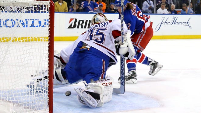 Carl Hagelin of the Rangers scores a short-handed goal against goalie Dustin Tokarski of the Montreal Canadiens on Monday night.