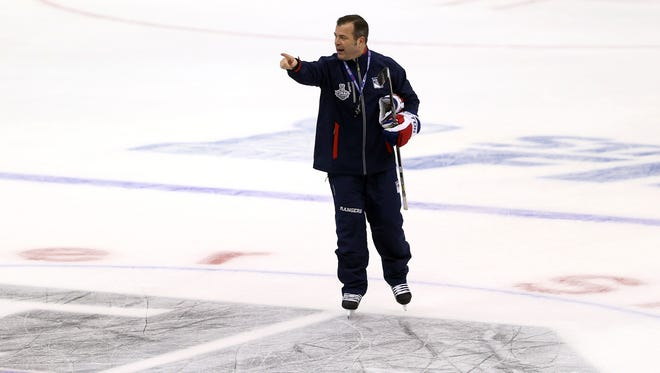 Alain Vigneault, head coach of the New York Rangers, looks on during a practice session ahead of the 2014 NHL Stanley Cup Final at Staples Center on June 3, 2014 in Los Angeles, California.