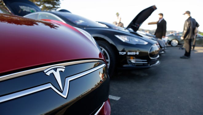 A row of Tesla Motors Model S electric sedans are shown during a demonstration Thursday, Oct. 31, 2013, at Crissy Field in San Francisco.