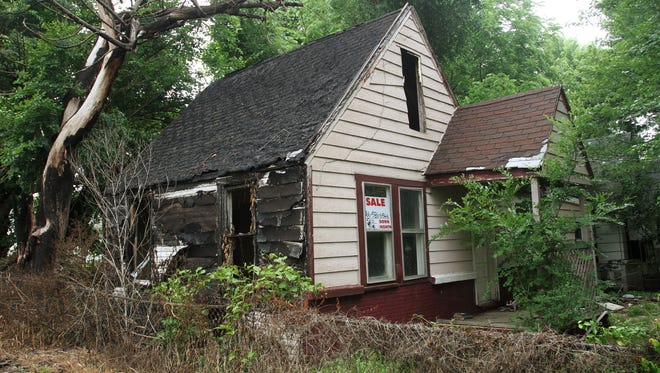 This house used to be located at 2433 Cottage. It was classified as a dangerous building and was demolished by the city. The photo was from Monday, June 9, 2014.