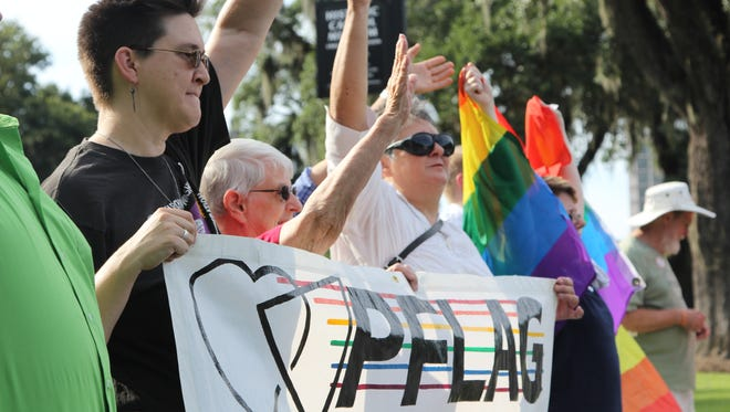 Gay-rights advocates gathered at the old Capitol Thursday evening to celebrate a decision by a judge in the Florida Keys to overturn the state's constitutional ban on same-sex marriage.