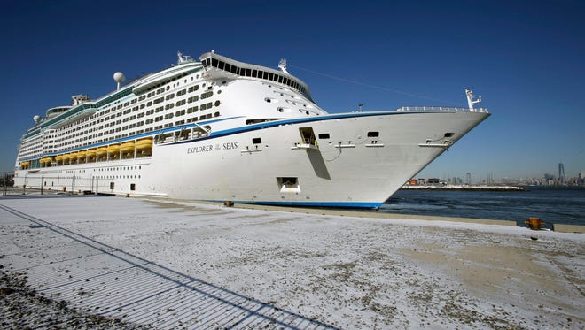 The Explorer of the Seas cruise ship is docked at a berth after arriving, Wednesday, Jan. 29, 2014, in Bayonne, N.J. The number of passengers and crew reported stricken ill on the cruise ship has risen to nearly 700. The U.S. Centers for Disease Control and Prevention said Wednesday its latest count puts the number of those sickened aboard the Explorer of the Seas at 630 passengers and 54 crew members. (AP Photo/Mel Evans) ORG XMIT: NJME107