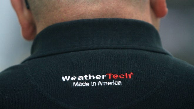 MacNeil Automotive Products employees wear shirts in the WeatherTech production facility in Bolingbrook, Ill.