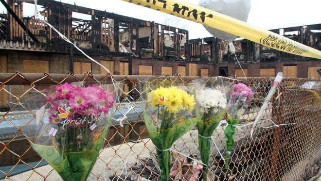 A makeshift memorial is seen at the Mariners Cove Motor Inn in Point Pleasant Beach, N.J. The motel was decimated by an early morning fire March 21, 2014, that took the life of four people.