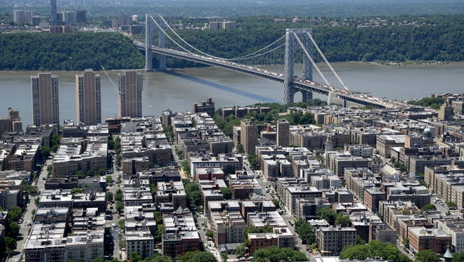The George Washington bridge spans the Hudson River between New Jersey and New York.