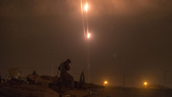 Rockets, photographed from Israel border, shows rockets being fired from the Gaza Strip into Israel, on July 19.