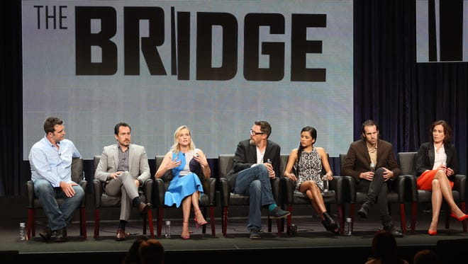 BEVERLY HILLS, CA - JULY 21:  (L-R) Executive producer Elwood Reid and actors Demian Bichir, Diane Kruger, Matthew Lillard, Emily Rios, Tom Wright and Franka Potente speak onstage at 'The Bridge' panel during the FX Networks portion of the 2014 Summer Television Critics Association at The Beverly Hilton Hotel on July 21, 2014 in Beverly Hills, California.  (Photo by Frederick M. Brown/Getty Images) ORG XMIT: 501967179 ORIG FILE ID: 452491746