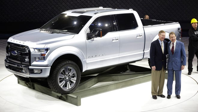 Ford Motor Co. Executive Chairman Bill Ford, right,  CEO Alan Mulally stand next to the Ford Atlas concept pickup after its unveil at the North American International Auto Show in Detroit last January