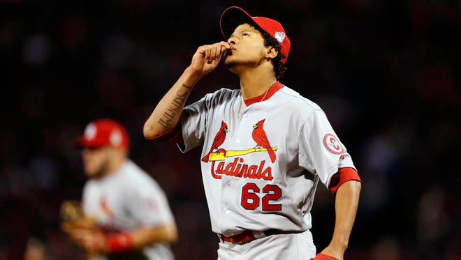 Carlos Martinez initially signed with the Red Sox as a 17-year-old in February 2009.