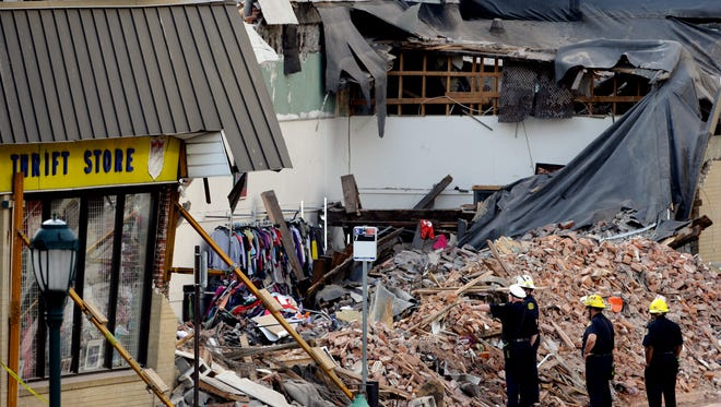 Firefighters view the aftermath of a building collapse  June 6, 2013, in Philadelphia.