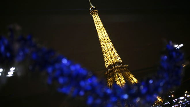 The Eiffel Tower in Paris is shown on Christmas Eve.