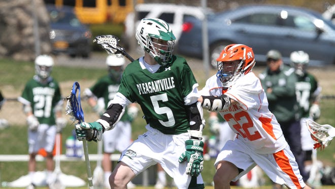 Mamaroneck defeated Pleasantville 10-8 in a boys lacrosse game at Mamaroneck High School April 17, 2014.