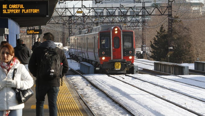 Commuters wait for the train at the Metro-North Port Chester train station on Feb. 20, 2014.