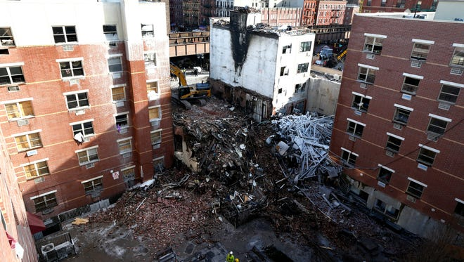 Using sound devices to probe for voices and telescopic cameras to peer into small spaces, workers searching a pile of rubble from a gas explosion in East Harlem continued to treat it as a rescue operation.