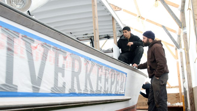 Builder Chris Brennan, right, works with apprentice Carlos Duran on Riverkeeper's patrol boat at Brennan Boatbuilding in Ossining on April 5.