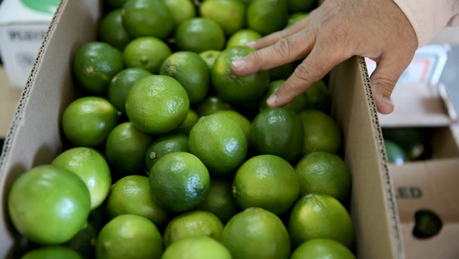 Marco Carmenatis prepares a box of limes that have been imported from Columbia for shipping to a customer at Marco produce on March 26, 2014 in Miami, Florida.  Mr. Carmenatis said they hadn't received any lime imports from Mexico for the last three days as a tight supply in Mexico has driven up the availability as well as the prices for the citrus in the United States.