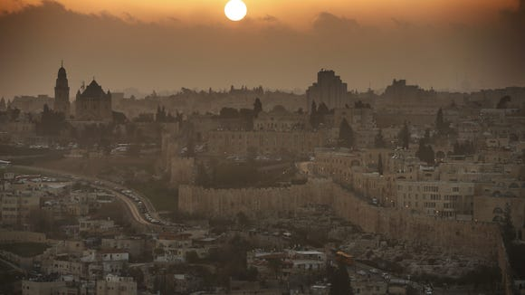 A partial view of the Old City of Jerusalem during sunset, on February 22, 2014. On the left the Christian Abbey of the Dormition.