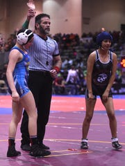 Reed's Mariah Ortiz, left, gets a quick pin and victory