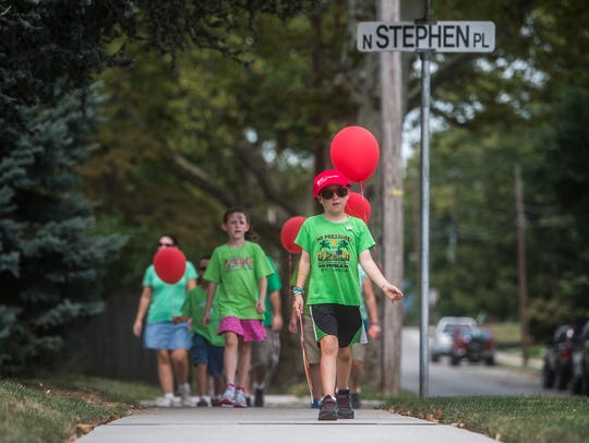 Gavin Minetola, 9, heads into the home stretch of the