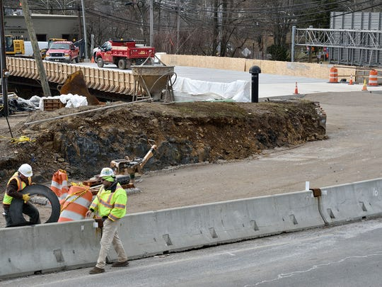 Construction crews work on the Notch Road Bridge over Route 46 in Woodland Park on Monday, March 5, 2018.