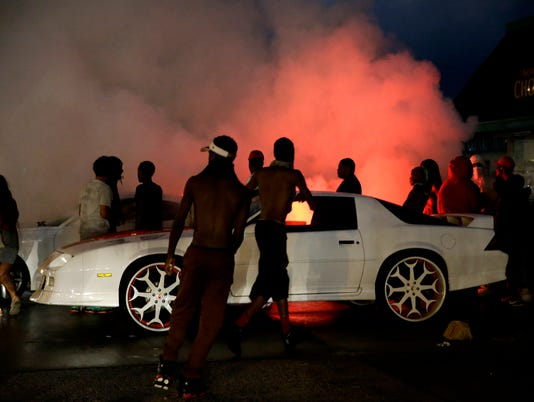 Shots ring out as Ferguson protesters mark anniversary of shooting