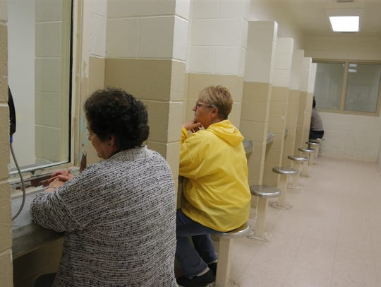 Visitors to the Monterey County Jail wait to visit