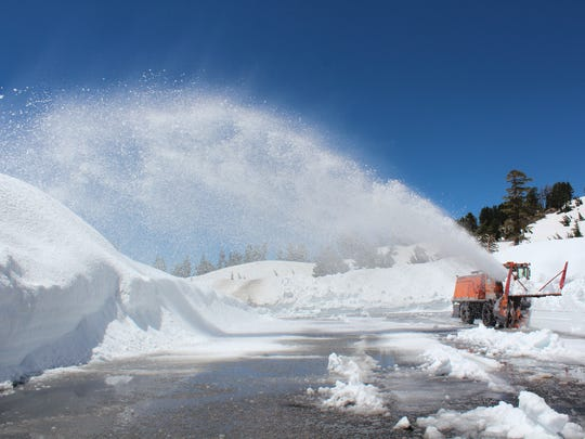 A snow-blower in July 2017 works to make the roadway