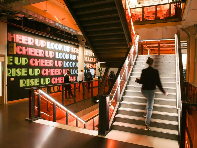An employee walks up the stairs at Facebook's new London