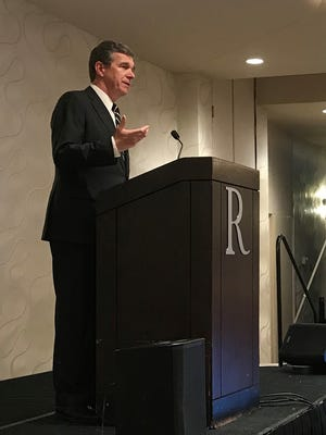Gov. Roy Cooper speaks to a meeting of educators in Asheville Tuesday.
