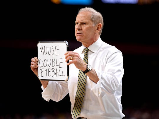 Michigan coach John Beilein and the Wolverines embraced