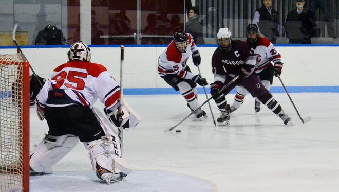 Scarsdale forward Stephen Nicholas attempts to get through pressure during a 6-2 loss to Rye on Wednesday at Playland Ice Casino.