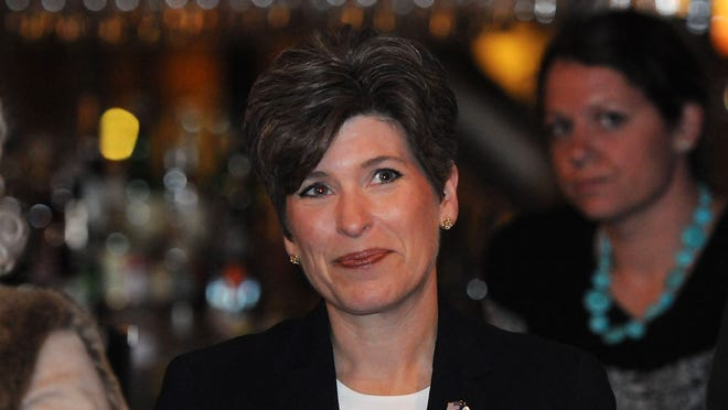 AMES, IA - OCTOBER 30:  Republican candidate for the U.S. Senate, Joni Ernst, waits to speak at a rally upon the completion of her tour of all of Iowa's 99 counties on October 30, 2014 in Ames, Iowa. Ernst is in a tightly contested Senate race against Democratic Challenger Bruce Braley to fill the vacant seat of retired Senator Tom Harkin.  (Photo by Steve Pope/Getty Images) ORG XMIT: 520549323 ORIG FILE ID: 458133870