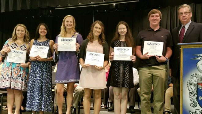 McDowell County Chamber board chair Eddie Shuford, far right, presents LINC students with $500 scholarships - (from left) Danielle Byrd, Carla Cervantes, Hannah Mitchell, Jessica Rodrigues, Amanda Warren and Jacob Whitson.